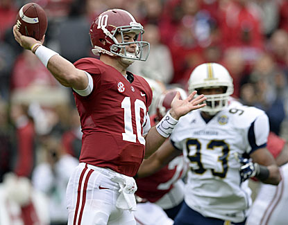 AJ McCarron runs his record to 36-2 as a starter, breaking a tie with Jay Barker for most wins at Alabama. (USATSI)