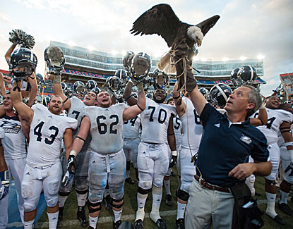 Georgia Southern players celebrate with their eagle mascot after their victory at the Swamp.  (Getty Images)