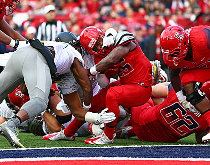 Arizona's Ka'Deem Carey breaks the goal line for one of his four touchdowns in the Wildcats' upset of Oregon. (USATSI)