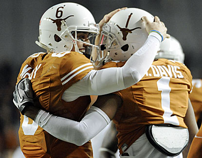 Case McCoy and Mike Davis have plenty to celebrate as the Texas Longhorns roll to a 41-16 win over Texas Tech. (USATSI)