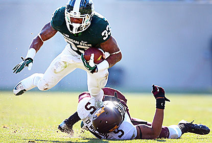 Jeremy Langford runs for 134 yards and one TD for the Spartans, who go unbeaten in the Big Ten for the third time (1965, '66). (USATSI)
