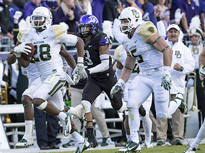 Baylor safety Orion Stewart returns an interception 82 yards for a touchdown right before the half. (USATSI)