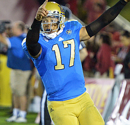 "Brett Hundley rushes for a pair of touchdowns and makes the bold statement that ""UCLA runs LA now."" (USATSI)"