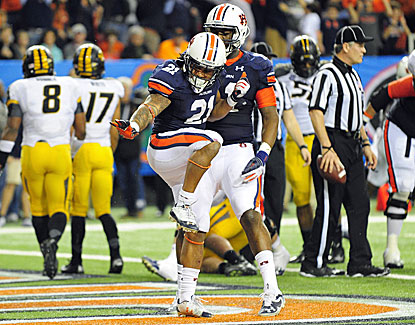 Auburn's Tre Mason runs for 304 yards and four TDs as Auburn rolls to a win over Missouri in the SEC championship. (USATSI)