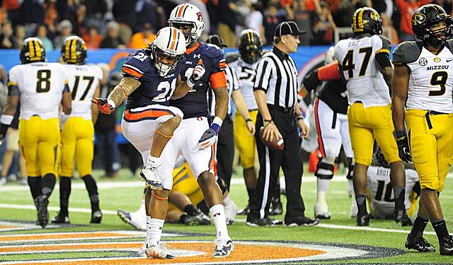 Tre Mason finds time to make a statement move during his statement SEC title game. (USATSI)