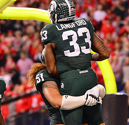 Michigan State scores the final 17 points to upset Ohio State and earn a berth in the Rose Bowl.  (USATSI)