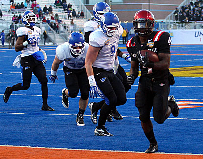 Adam Muema trots into the end zone for one of his three touchdowns in the Aztecs' rout of Buffalo. (USATSI)
