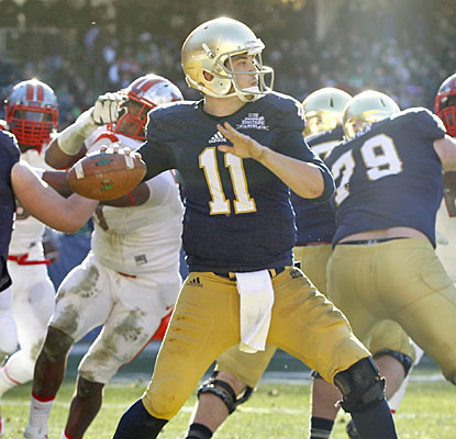 Tommy Rees hits on 27 of 47 passes for 319 yards against Rutgers in his final game for Notre Dame.  (USATSI)