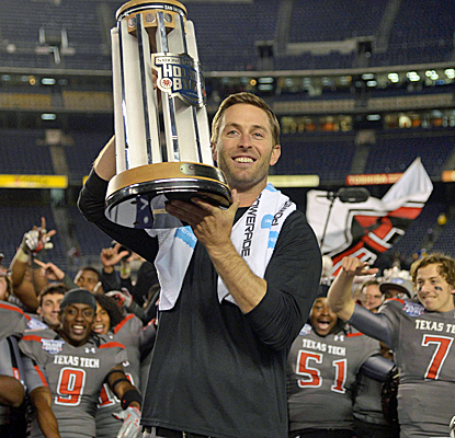 Texas Tech coach Kliff Kingsbury holds up the Holiday Bowl trophy after his Red Raiders defeat Arizona State.  (USATSI)