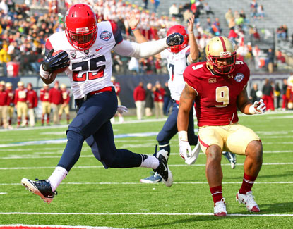 Arizona's Ka'Deem Carey, who rushes for 169 yards, crosses the goal line for one of his two touchdowns against Boston College. (USATSI)