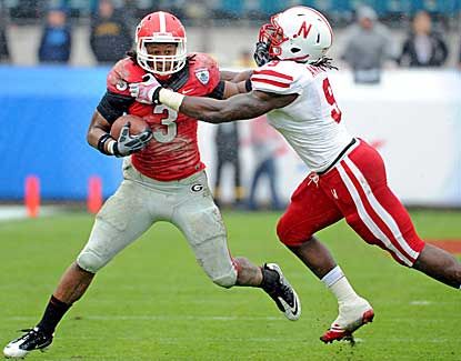Nebraska's Jason Ankrah tries to put the clamps on Georgia running back Todd Gurley.  (USATSI)