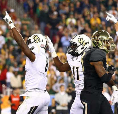 Storm Johnson (left) scores three touchdowns and totals 124 yards rushing as the Knights win their BCS bowl debut.  (USATSI)