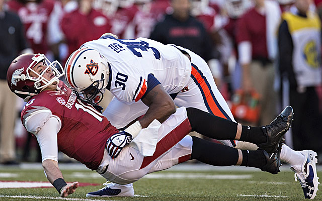 Auburn defensive end Dee Ford made life tough for SEC quarterbacks in 2013. (Getty)