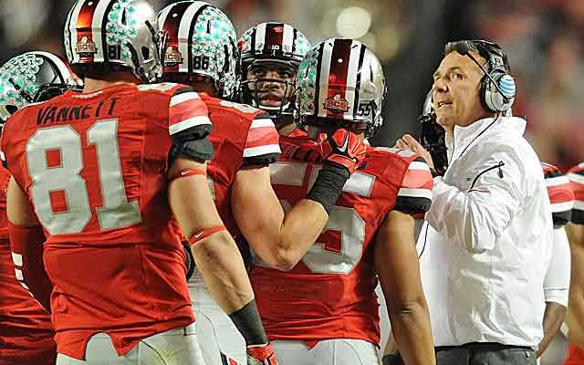 Top coaches like Urban Meyer get paid millions annually while players continue to play for scholarships.  (USATSI)