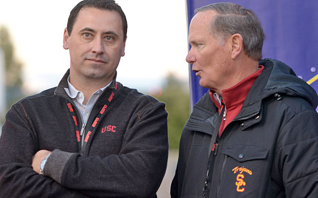 Steve Sarkisian (left, with AD Pat Haden) is the latest coach to attempt to trademark his name. (USATSI)