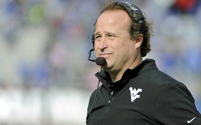 Dana Holgorsen needs to find a consistent quarterback for the Mountaineers. (USATSI)
