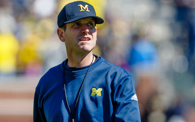 Jim Harbaugh pushes for the very best from his young QBs. (USATSI)