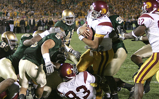 Matt Leinart found his way across the plane with a little help. (Getty Images)