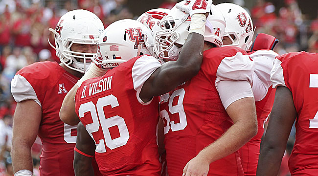 Houston romps past Navy for AAC West title