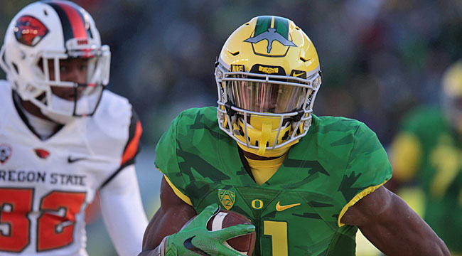 No. 17 Oregon hangs on for win over Oregon State