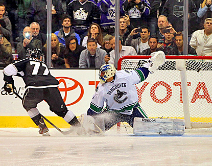 Jeff Carter scores on Vancouver goaltender Roberto Luongo during the shootout to win the game.  (Getty Images)