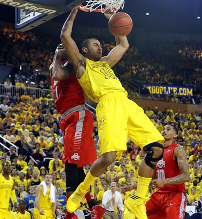 Michigan's Jon Horford (right) dunks while Ohio State's Deshaun Thomas defends during the Wolverines' OT win. (AP)
