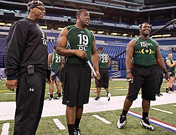 Will Nick Fairley (19) be a more productive pro than Marcell Dareus (right)? Their college numbers say yes. (US Presswire)