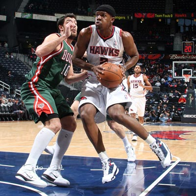 The Hawks' Joe Johnson scores 28 of his 36 points in the first half against the Bucks.  (Getty Images)
