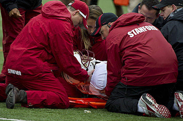 Chris Owusu is taken off the field after suffering a concussion at Oregon State. (US Presswire)