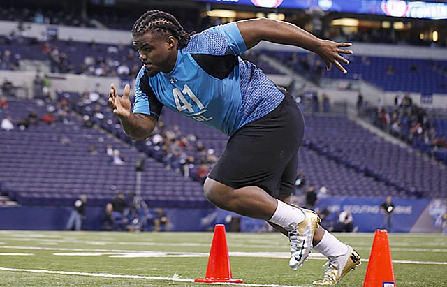 At 346 pounds, Dontari Poe runs the 40 in 4.98 seconds at the combine. (US Presswire)