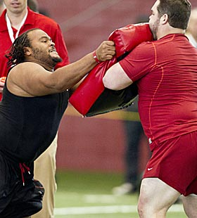 Alfred McCullough (left) and William Vlachos (right) do pro day drills. (AP)