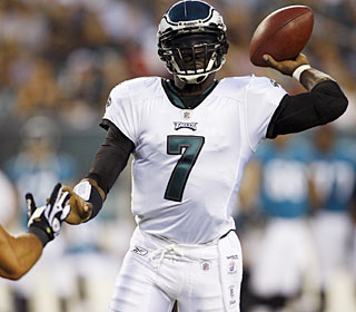 Michael Vick completes 11 of 17 passes for 119 yards -- and adds 50 rushing yards.  (AP)