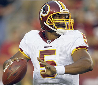 In his brief Redskins debut, Donovan McNabb throws a touchdown pass in his two series of work.  (AP)