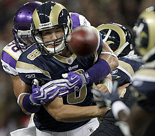 The Vikings defense contains Rams rookie QB Sam Bradford, who finishes 6 of 13 for 57 yards.  (AP)