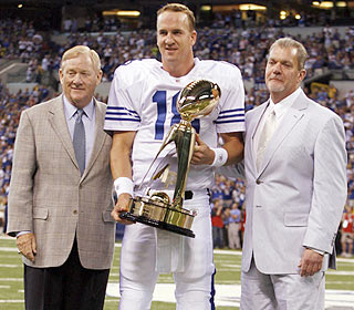 Good times, good times. Peyton Manning picks up his MVP trophy then plays two series. (US Presswire)