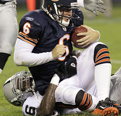 Raiders linebacker Kamerion Wimbley records one of his four sacks on Jay Cutler as the Raiders roll.  (AP)