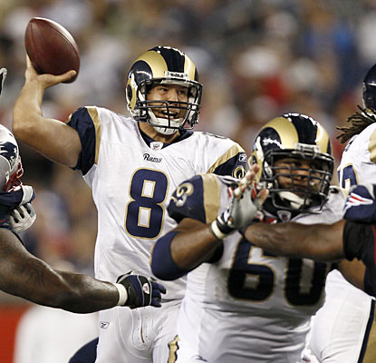 Sam Bradford looks the part in his first start, completing 15 of 22 attempts for 189 yards and two TDs. (AP)