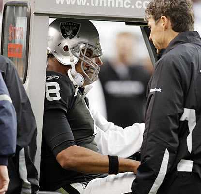 Starting quarterback Jason Campbell exits the game in the second quarter after he suffers a stinger, according to the Raiders.  (AP)