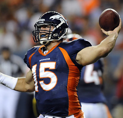 It's not the sharpest home debut for Tim Tebow (5 of 10 for 72 yards, INT) but the Broncos rookie does manage to throw a TD.  (AP)
