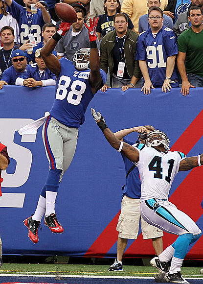 Hakeem Nicks leaps to make his second TD catch as the Panthers' Captain Munnerlyn watches.  (Getty Images)