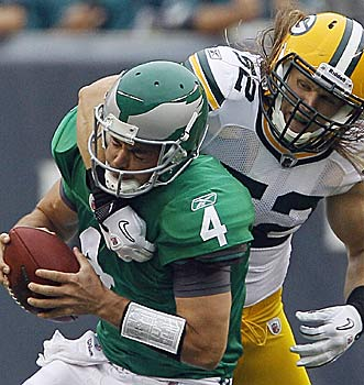 Kevin Kolb is hammered by Clay Matthews and winds up with a concussion. (AP)