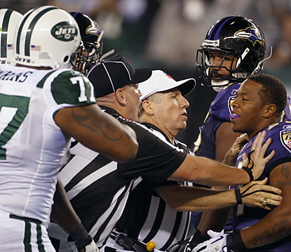 The talking begins early as the Jets' Shaun Ellis (not shown) and Ray Rice get separated by officials before the game.