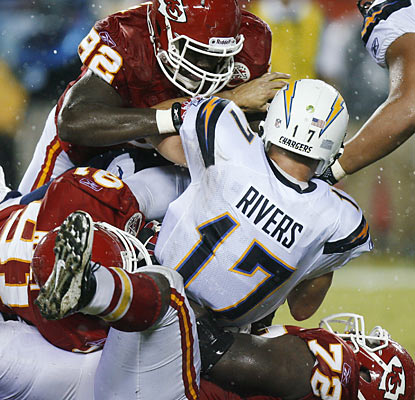 The Chiefs defense flexes its muscles by harassing quarterback Philip Rivers early and often in the season opener.  (AP)