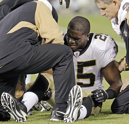 While the Saints pull out a big win, they suffer a potentially huge loss when Reggie Bush injures his leg on a muffed punt.  (AP)