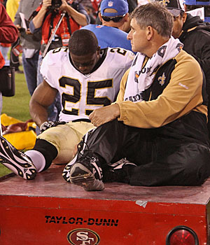 Reggie Bush's leg injury will force the Saints to change their game plans. (Getty Images)