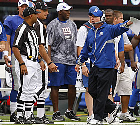 Tom Coughlin looks for help from the officials. Could he be searching for employment next? (US Presswire)
