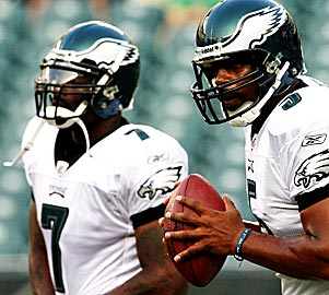 Oh, the irony: McNabb helped convince the Eagles to sign Vick. (Getty Images)