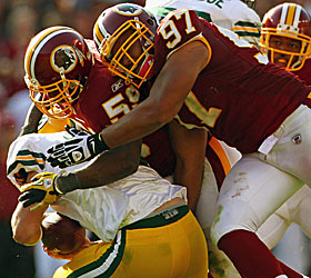 The Redskins bury Aaron Rodgers again, eventually concussing the QB. (Getty Images)