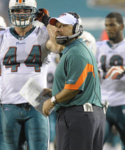 Fair or not, a porous effort from the Dolphins' special teams unit cost John Bonamego his job. (AP)