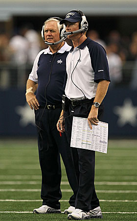 Cowboys coach Wade Phillips (left) and assistant Jason Garrett look for answers, and find squat. (Getty Images)